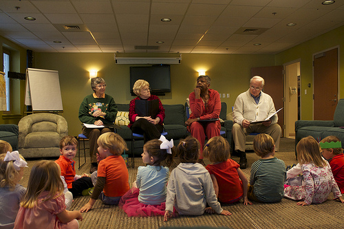 (From left to right) Seasoned Performers M.H. Smith, 72, Leighanne Botters, 71, Janice Wilson, 70, and Henry Lapidus, 79 read an original play to preschoolers at Birmingham's Independent Presbyterian Church on October 25. Photo by Jordyn Taylor.