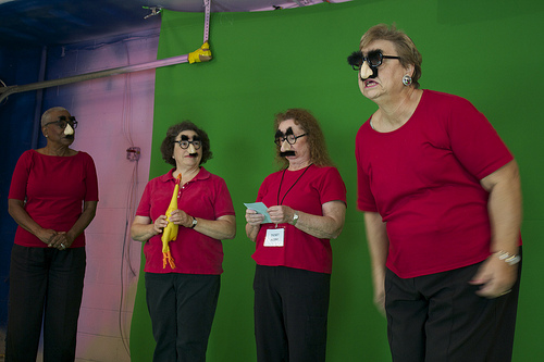 (From left to right) Seasoned Performers Marva Douglas, in her seventies, Elise Bodenheimer, 60, Pauline Neilson, in her sixties, and Phyllis Landers, in her sixties, don Groucho glasses and deliver jokes to the camera. Photo by Jordyn Taylor.