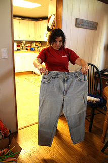 Ann Couch, 47, of Birmingham, Ala. holds up a pair of her size 26 pants from before her gastirc bypass surgery in 2003. Photo by Zoe Lake.