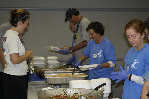 Amy Saag, 57 (second from right) serves up cabbage rolls and couscous to a guest at the Birmingham JCC's Jewish Food Festival on Oct. 27th. Photo by Jordyn Taylor.